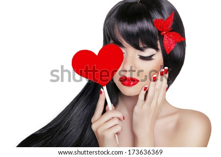 Beautiful Brunette Woman with Healthy Long Black Hair. Valentine girl. Beauty Glamour Fashion model portrait holding heart isolated on white background. - stock photo