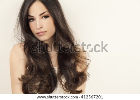 beautiful brunette woman with long healthy hair, studio white - stock photo