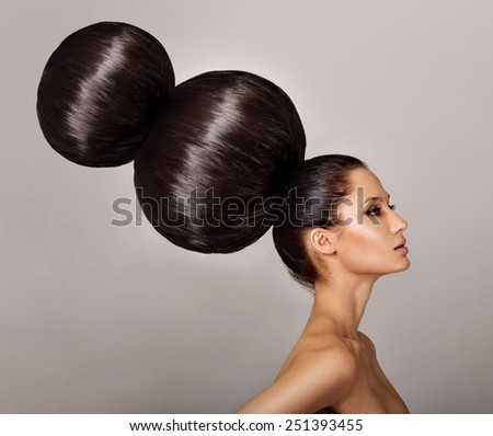 Beautiful brunette woman with magnificent hair. professional hairstyle. - stock photo
