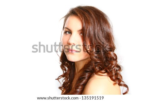 Beautiful brunette woman with naked shoulder looking at the camera on white background