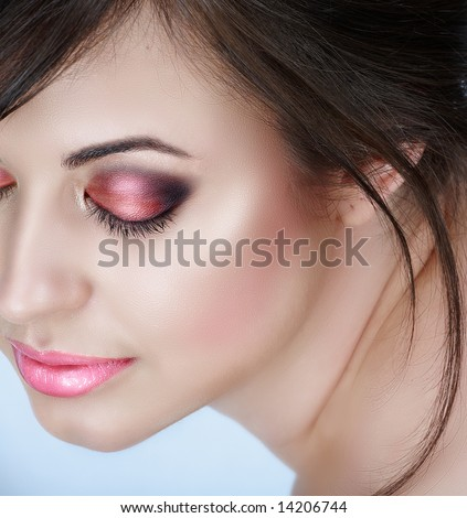 Beautiful brunette woman with pink smoky eyes eyeshadow and soft smile ? natural make-up with good skin texture - stock photo
