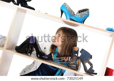 beautiful brunette young woman choosing shoes at a store. Isolated on white background - stock photo