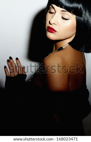 Beautiful Brunette young Woman. Healthy Black Hair. bob Haircut. red lips. beauty Girl. Sexy - stock photo