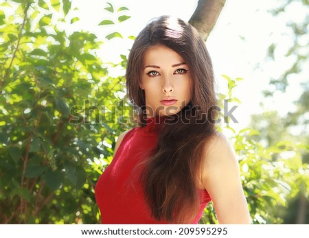 Beautiful brunette young woman looking sexy outdoors background - stock photo