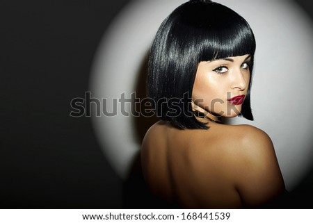 Beautiful Brunette young Woman. Retro style. Healthy Black Hair. bob Haircut. red lips. beauty Girl. Sexy - stock photo