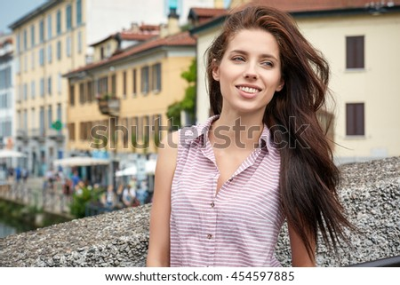Beautiful brunette young woman tourist  walking on the street