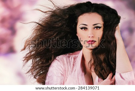 Beautiful brunette young woman with fresh makeup. Spa treatment. - stock photo