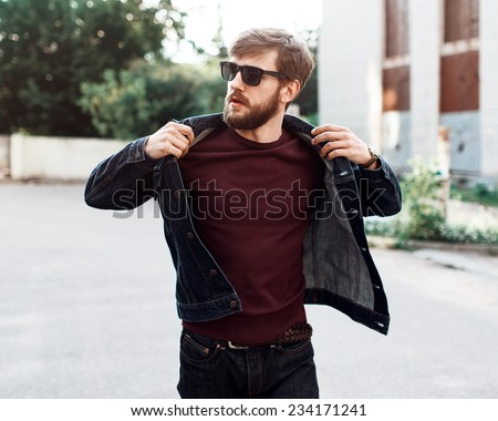 Beautiful brutal man with a beard and glasses