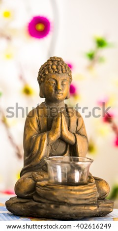Beautiful buddha statue put the palms of the hands together in salute./ Buddha statue - stock photo