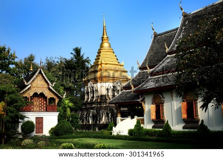 Beautiful Buddhist temple with golden stupa in Chiang Mai, Thailand - stock photo