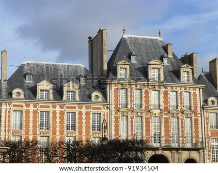 Beautiful buildings of Place des Vosges, square in Paris, France, third arrondissement near Le Marais. - stock photo