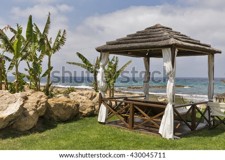 Beautiful bungalow for relaxation on the Mediterranean sea beach in Paphos, Cyprus. - stock photo