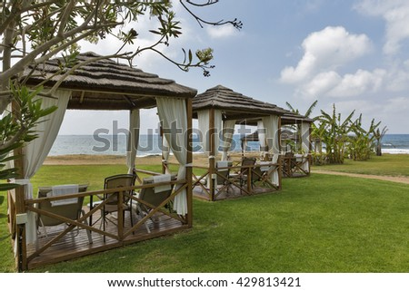 Beautiful bungalows for relaxation on the Mediterranean sea beach in Paphos, Cyprus. - stock photo