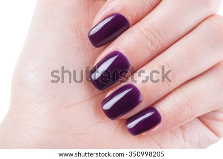 Beautiful burgundy nails close up. - stock photo