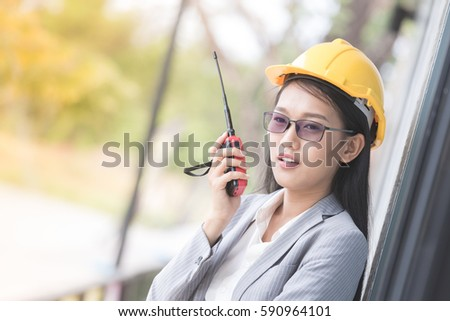 beautiful business asian woman use radio transmitting and receiving equipment