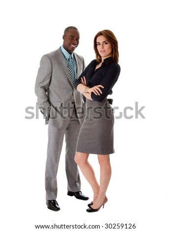 Beautiful business couple African American man and Caucasian woman standing, isolated - stock photo