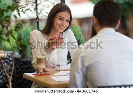 Beautiful business couple in a cafe on a laptop in a cafe