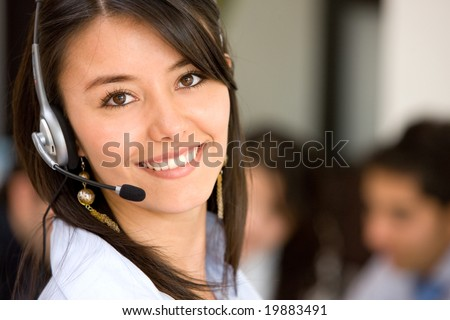 beautiful business customer service woman - smiling in an office - stock photo
