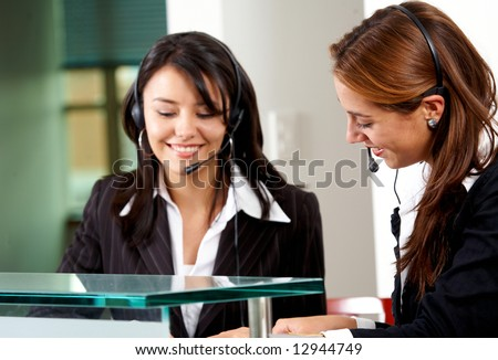 beautiful business customer service women - smiling in an office - stock photo