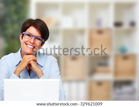 Beautiful business lady with laptop computer in office.