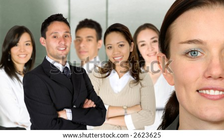 beautiful business woman and her team in an office - stock photo