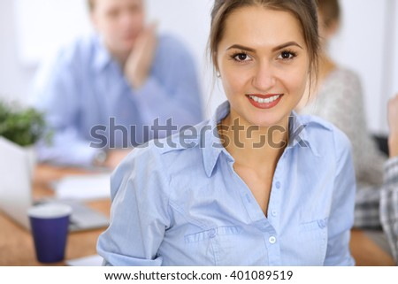 Beautiful business woman at meeting. Casual clothing style. Start up team. - stock photo