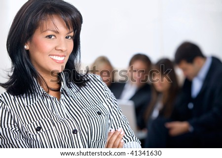 Beautiful business woman at the office smiling - stock photo