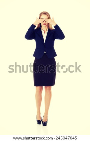 Beautiful business woman covering her eyes.  - stock photo