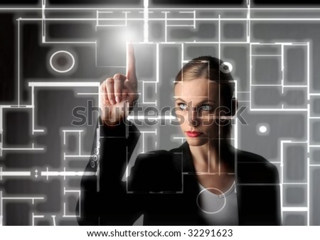 beautiful business woman drawing a digital blueprint - stock photo