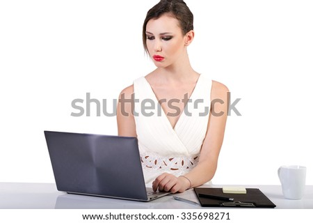 Beautiful business woman dreaming while working on computer at her office - stock photo