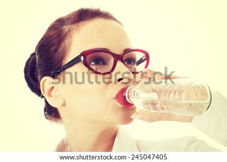 Beautiful business woman drinking water. - stock photo