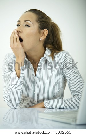 Beautiful business woman during daily office routines - stock photo