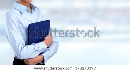 Beautiful business woman hands with folder. - stock photo