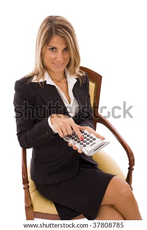Beautiful business woman holding a calculator - stock photo