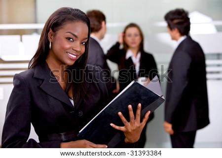 Beautiful business woman holding a portfolio - stock photo