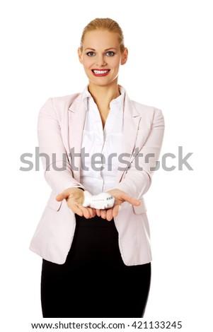Beautiful business woman holding airplane model - stock photo