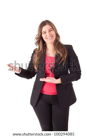 Beautiful business woman holding and presenting a product on white background - stock photo