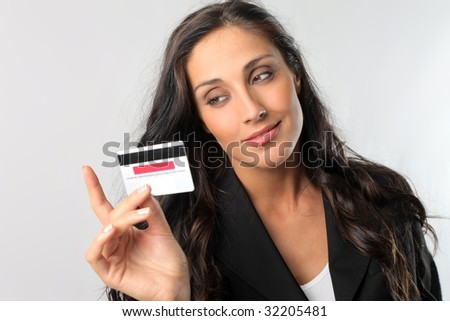 beautiful business woman holding credit card - stock photo