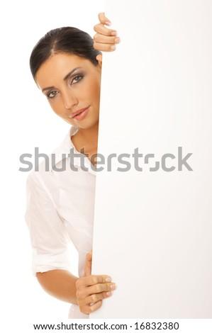 Beautiful business woman holding empty white board - stock photo