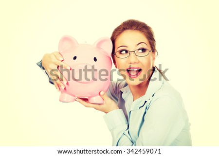Beautiful business woman holding piggy bank.