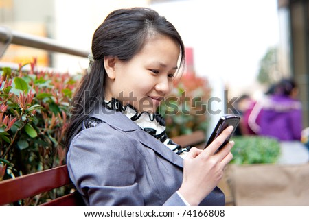 Beautiful business woman in the mobile browser - stock photo