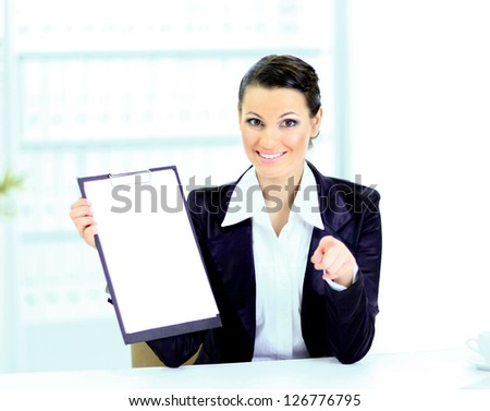 Beautiful business woman in the office, at the work place with the work plan. - stock photo