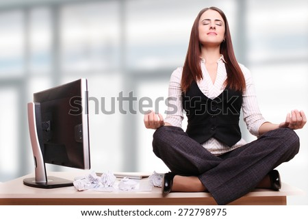 Beautiful business woman is dreaming in his office - stock photo