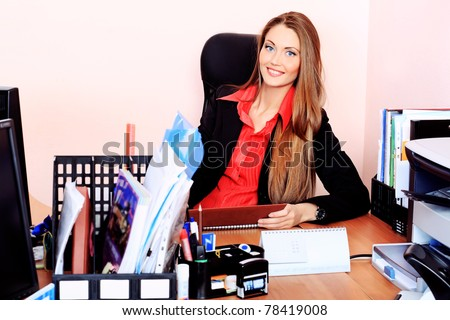 Beautiful business woman is working at the office.