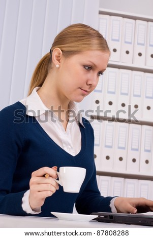 Beautiful business woman is working in office - stock photo
