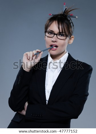beautiful business woman on isolated bacground thinking cheewing her pencil - stock photo