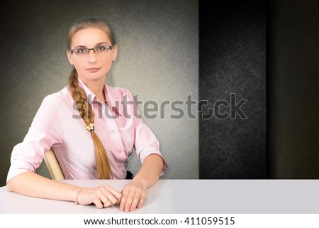 Beautiful business woman on the background. girl in the office, girl with glasses working on a job interview