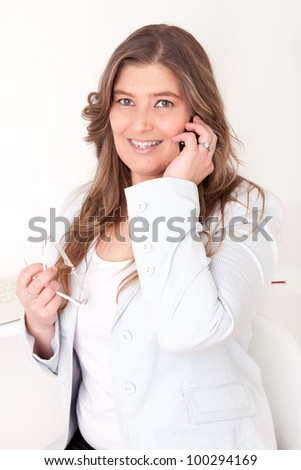Beautiful business woman on the phone - stock photo