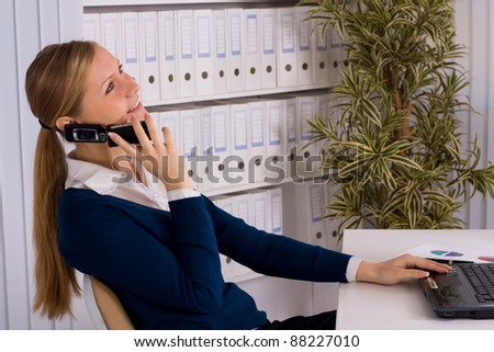 beautiful business woman on the phone at office - stock photo
