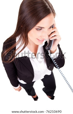 beautiful business woman on the phone on a white background - stock photo